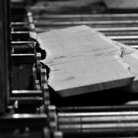 as waney edge boards come off the bandsaw they fall to the rollers and get picked up and laid together to be made into boules