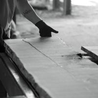 boards being taken off the bandsaw at helmdon sawmill to make waney edge boules of english oak for Cocking sawmill