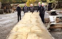 the guys at cocking sawmills standing around a boule over 8m long taking in the enormity of the boards of big timber