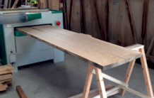 plane a waney edge board for an instant dining table