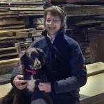 jill in accounts with her dog tilly in the timbershetd