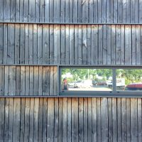 weathered and silvered fresh sawn timber cladding