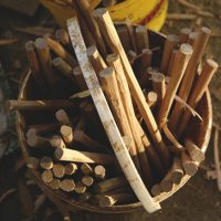 a bucket of oak pegs fresh off the shavehorse at downland workshops