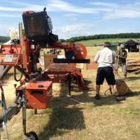 cowards loading logs on the mobile bandsaw