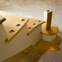 hand making a bespoke staircase in teh workshop of james pillier joinery