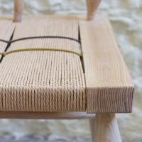 detail of woven seat windsor bench by petrel furniture