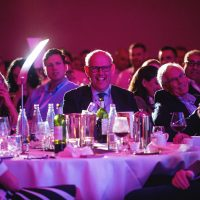 combilift table happy Tom Compton at TTJ Awards winning Small Timber Business of the Year with Combilift