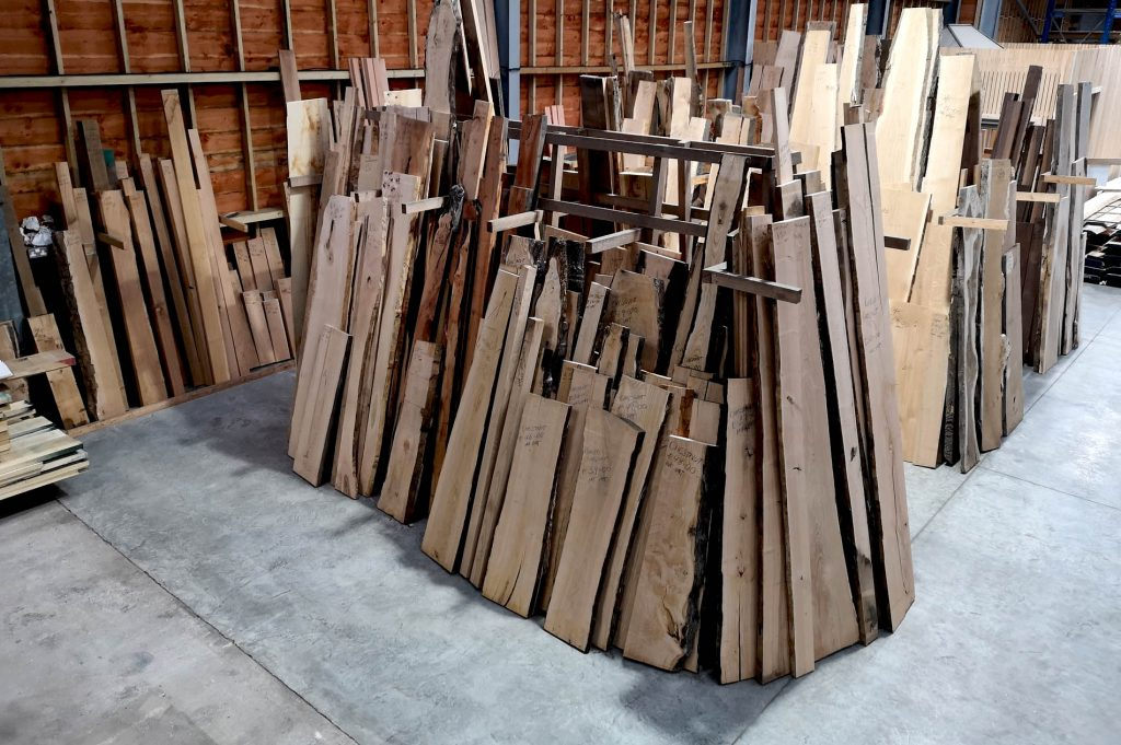 the hardwood timber rack rammed to the gunwhales ready for the 50% off sale in January in english wodlands timber woodyard