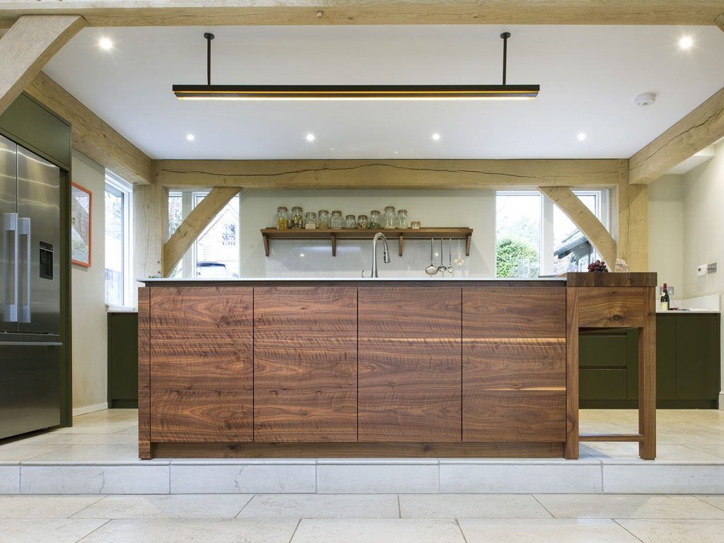 a beautiful kitchen interior built by inglis hall in walnut and deep moss green winchester