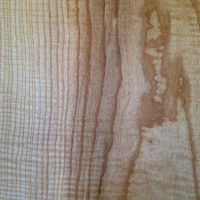 a detail of a rippled ash board on display in the office