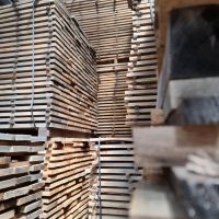 OAK SQUARE EDGE PACKS STACKED in the air dried yard whilst they season for timber cladding