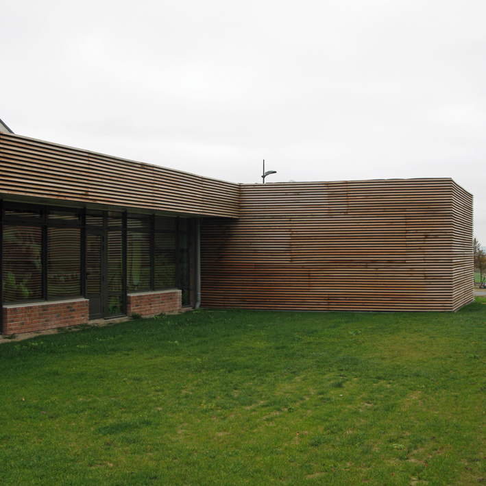 French motorway services Building with Larch cladding and big glazed curtain walls