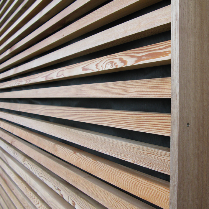 French motorway services Building with Larch cladding & western red cedar doorway detail
