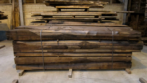 waney edge walnut boards in the kiln dried stock shed at cocking sawmills